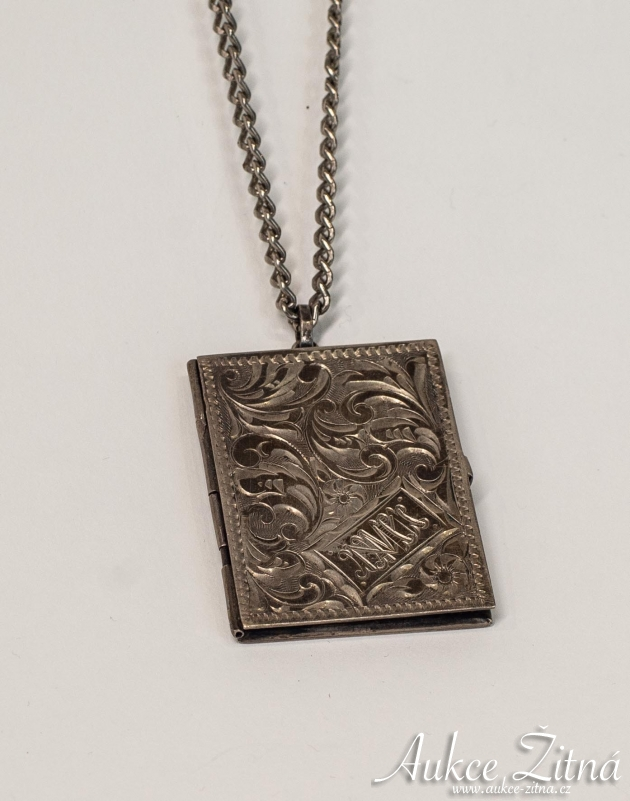 Silver opening locket in the shape of a book